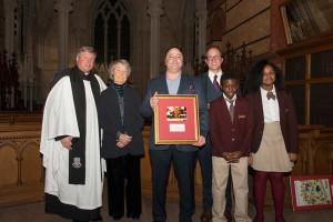 Di Bruno Bros. President William Minucci, Jr. accepts award of recognition