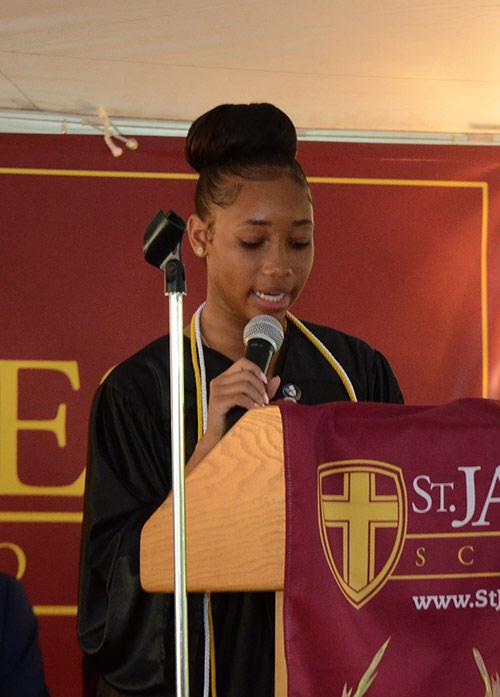 Valedictorian Ainyae Holmes speaks to her classmates.