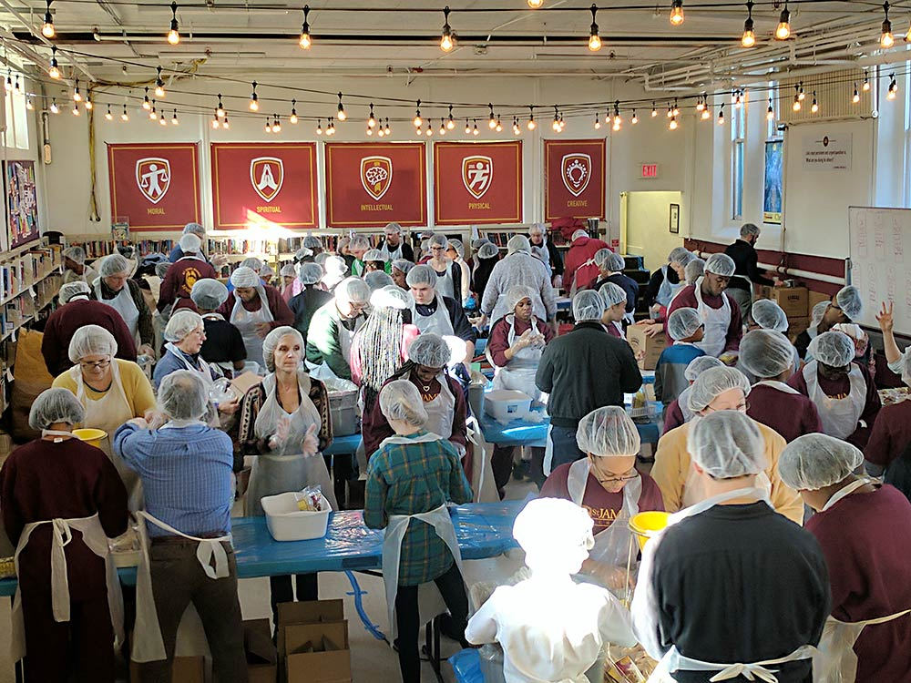 Packaging 12,000 meals at St. James School on MLK Day 2017