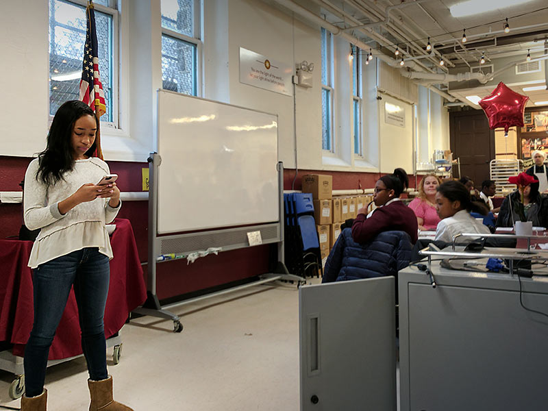 Alumna Ainyae Holmes addresses students at On A Roll Breakfast