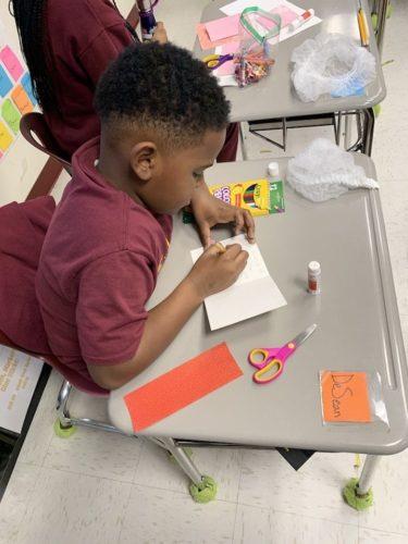 4th grader DeSean creating a card