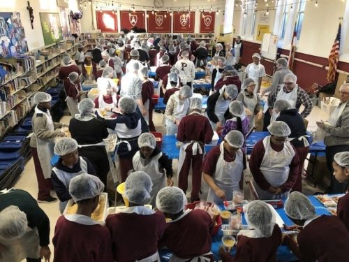 whole school community doing MLK Day service project