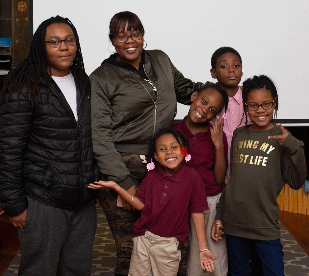 St. James School students Jonathan and Journee with their family